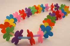 "lei craft for kids - using 1"" bright straw pieces and punch out flowers from paper"