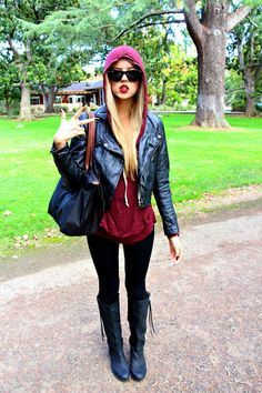 leather jacket and hoodie layered