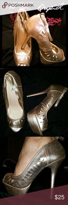 Peep Toe Platform Heels Brand new 4.5 inch heels with 1.25 inch platform. Shoe has ankle strap and triangle cut outs. Gold Color. New in the box. Qupid Shoes Heels