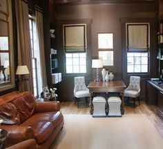 Magnolia Custom Homes - dens/libraries/offices - shared desk, dark den, den, tufted chairs, white tufted chairs, leather sofa, grosgrain roman shade,