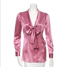"EUC Dolce & Gabbana blouse Silk 96% Pink Dolce & Gabbana button-up with ruffles at shoulder blouse. It's a medium. It fits 4-6 sizes. Bust 34"", waist 32"", length 27"". Dolce & Gabbana Tops Blouses"