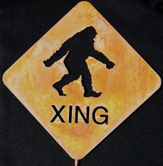 Bigfoot Sasquatch or Yeti Crossing Metal Yard  Art or Garden Stick Sign. $28.00, via Etsy.