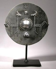 Display stand for a 9th Century Viking silver Sol (sun) disk