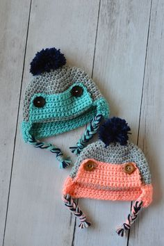 Button Eskimo Baby Hat - This cozy hat is a cute and fun baby accessory for winter! {Free pattern by Whistle and ivy}