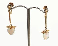 Vintage opal dangle earrings in 9 carat gold setting, white opal hearts with multi colored lights, 3 grams by CardCurios on Etsy Butterfly Earrings, Screw Back Earrings, White Opal, Carat Gold, Gemstone Colors, Vintage Earrings, Light Colors, Heart Shapes, Dangle Earrings