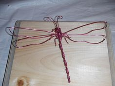 In this video I show you step by step how to make a dragonfly using wire