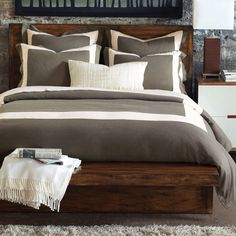 Am loving the dark wooden bed.     Breeze Pearl Duvet Cover by Eastern Accents