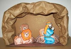 knutselwerkje diorama Daniel in de leeuwenkuil Bible craft Diorama Daniel in the Lions Den Patterns are in the book: Bible crafts Mary Currier Teacher Created Resources Sunday School Projects, Sunday School Kids, Sunday School Activities, Church Activities, Bible Activities, Sunday School Lessons, Bible Story Crafts, Bible School Crafts, Bible Crafts For Kids