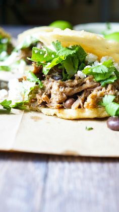Venezuelan Pork Arepas. Slow roasted pork with spiced black beans, cotija cheese, and cilantro all stuffed inside a cornmeal arepa.