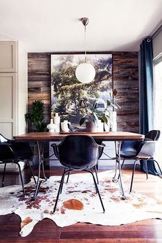 eames dax chairs, ceiling-size art,reclaimed wood walls