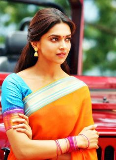Deepika. The beautiful stunning sarees deepika wore in chennai express are really simple yet georgeous. you can jazz up this saree in pretty yet simple jewellery and will look nice to weddings/parties etc..