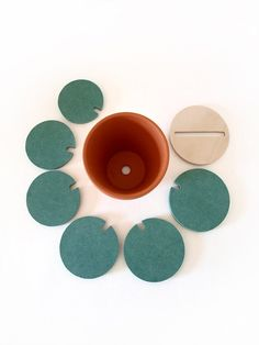 Please Note: Light Green version only shown in the images above.  Cacti Coasters are designed to protect work surfaces whilst having the remarkable ability to blend into your environment by transforming into different shapes of cacti.  Each product is comprised of a terracotta pot, a birch plywood top, and six green water resistant discs precisely machined from high quality engineered wood.  Each disc is a slightly different size, providing surface protection for up to seven cups. This…