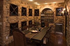 awesome wine cellar...would be so fun to have a dinner party here!