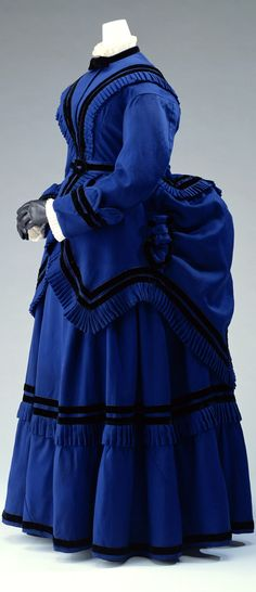 Day dress, England, ca. 1875. Blue wool twill; one-piece dress and overskirt. Kyoto Costume Institute
