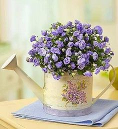 Pretty Lavender Flowers in a Vintage Yellow Watering Can