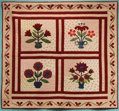 """Wall Quilt 21, """"Pretty in Red"""" by Mary Catherine Scott  """"I usually work mostly in blues but I was drawn to this happy red design when I first saw it. I like the combination of different light reds for the background and the bold statement made by the four large vases of flowers."""" Large Vases, Flower Vases, Flowers, Red Design, Different Light, Capital City, Blues, Mary, Quilts"""