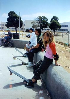 This photograph by Nikki. S. Lee is very interesting because three objects seat in a straight line, and the skateboard also in a same line and same angel. We learned that Nikki like play different role in her photograph, and she like to experience different kinds of lives and learn different culture. I think this is pretty cool when a person can change his identity  lightheartedly.