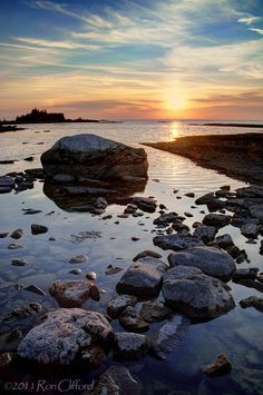 Sunset  over boulders on the  Lake Huron Shoreline.  Northern Bruce Peninsula Ontario Canada.  Part of a  World Biosphere Reserve