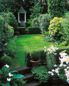 long thin garden rectangles and squares confined within low walls convey a very angular look although the harsh lines are softened by use of delicate