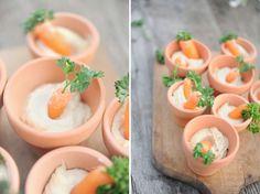 Tiny terra cotta pots with hummus and carrots! :-)