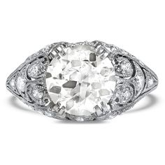 The Barrington Ring A total showstopper, this platinum Edwardian-era ring features a shimmering old European cut diamond surrounded by delicate milgrain dotted with accent diamonds for a look of old world glamour (approx. 2.98 total carat weight). $32,000