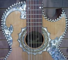 Checkout the incredible inlay work on this twelve string guitar from the Paracho Elite booth at NAMM 2013.