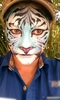 Tiger - I like the idea of doing the tiger nose under the person's actual nose. It gives it a more realistic look.