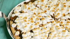 S'mores Pizza is exactly how you make s'mores for a crowd. A shortbread-inspired crust, with a healthy heaping of crushed graham crackers, a layer of melted chocolate chips, and a broiled layer of mini marshmallows that takes 20 minutes to make, and about 2 seconds to devour.