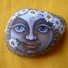 *really great face painted on rock!