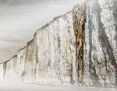 """""""The main idea behind this project is to inhabit the natural vertical geographical conditions. The vertical plane with zero occupancy offers the possibility, with the help of technology, to conquest the apparently inhospitable wall areas in order to preserve the green horizontal plane exclusi""""vely for wild life"""
