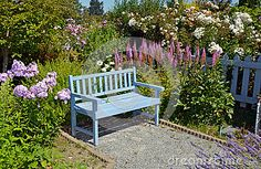 Blue garden bench by Iperl, via Dreamstime