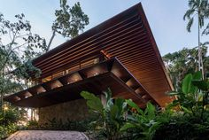 """Conceived as a beach house in its essence, this """"house-porch"""" or """"house-pergola"""" features large overhangs and few walls. Tropical Architecture, Wood Architecture, Residential Architecture, Origami Architecture, Contemporary Architecture, Brazil Wallpaper, Home Wallpaper, House With Porch, House In The Woods"""