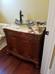 furniture vanity jeffrey alexander golden pecan cabinet glass vessel sink designed by angela raines