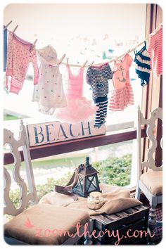 Nautical Baby Shower  ::  Have each guest bring a piece of clothing for the baby and hang it on the clothes line.  Cute!