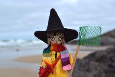 Celestine at the beach  -- that tiny scarf, oh my!