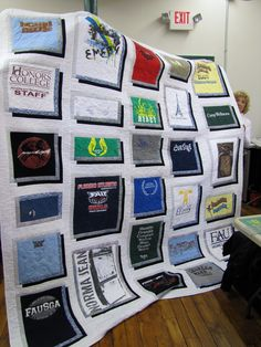 T-Shirt Quilt. I like who they framed the shirts.