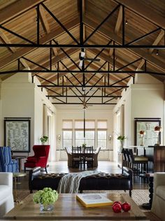 Amazing high exposed ceilings with black metal and wood trusses used to hold the roof up and scaffolding for ceiling fans jennifer robin interiors Exposed Trusses, Exposed Ceilings, Steel Trusses, Roof Trusses, Basement Ceiling Painted, Basement Ceiling Options, Ceiling Ideas, Basement Ceilings, Basement Bars