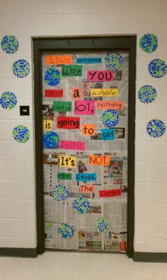 "Our new Earth Day door. Newspaper background. Quote from the Lorax ""unless someone like you cares a whole awful lot, nothing is going to get better. It's not"" and mosaic Earths. They loved making this!"