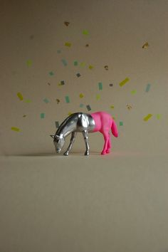 A plastic horse transformed with silver paint