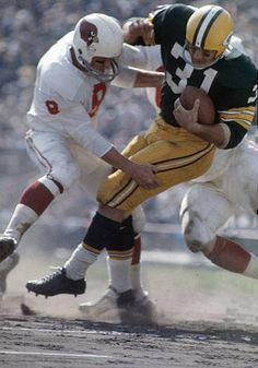 BAY WI CIRCA Running back Jim Taylor of the Green Bay Packers is tackled by St Louis Cardinals safety Larry Wilson circa NFL football. St Louis Cardinals Football, Nfl Arizona Cardinals, Stl Cardinals, Nfl Football Players, Packers Football, Football Cards, Nfl Photos, Football Photos, Sports Photos