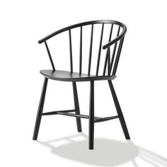 Johansson's chair draws a parallel to traditional Windsor, as well as Nordic folk furniture. The curved chair with sloping arms works as a comfortable dining ch
