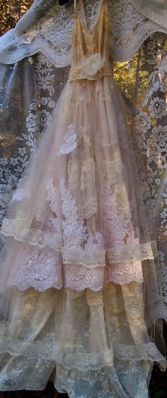 Lace Wedding Dress handmade by vintage opulence on Etsy  The top is a soft cream nylon with lace trims, adjustable ribbon shoulder straps and a