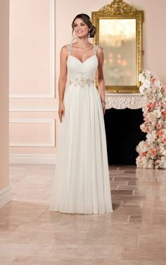 This Capri chiffon sheath romantic wedding dress by Stella York features a crisscross sweetheart bust with Diamante-encrusted shoulder straps and belt. The keyhole back zips up with ease under Stella crystal buttons.