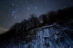 """Star Icefall. (Credit: Masahiro Miyasaka) Winner in the Earth & Space category of the Astronomy Photographer of the Year 2012. It shows a large icefall with the spires of ice seeming to reach up towards Orion, Taurus and the Pleiades in a dark, clear sky. ©Mona Evans, """"Astronomy Photographer of the Year 2012"""" http://www.bellaonline.com/articles/art178104.asp"""