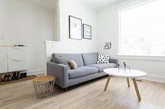 Scandinavian white + grey living room, grey sofa, Normann Copenhagen coffee table + Ferm Living basket