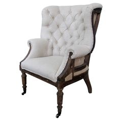 "Talmont Arm Chair - Rustic, Relaxed, Romantic on Joss and Main. Wood framed wingback chair. Upholstered in linen with button tufted back and nailhead trim. Casters on front legs. 43""H x 32""W x 32""D. $685.95"