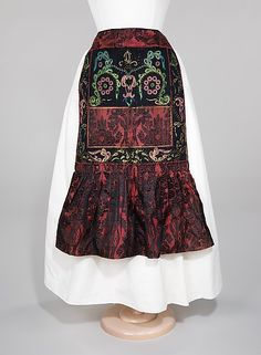 Apron Date: 1840–70 Culture: Spanish Medium: wool, silk, glass, metal, cotton Dimensions: Length at CB: 29 1/2 in. (74.9 cm) Credit Line: Brooklyn Museum Costume Collection at The Metropolitan Museum of Art, Gift of the Brooklyn Museum, 2009; Museum Expedition 1922, Robert B. Woodward Memorial Fund, 1922 Accession Number: 2009.300.55