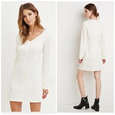 ❕2 Items for $15❕Cream shift dress Soft sweater like dress featuring slight bell sleeves and v neck from. From the F21 contemporary line. Made from polyester, spandex & rayon blend. It's a beautiful cream color. 🚫no trades. PRICE FIRM UNLESS BUNDLED Forever 21 Dresses Long Sleeve