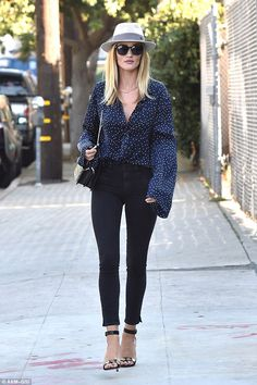 Business first! On Thursday it was business first, as Rosie Huntington-Whiteley was spotted strutting down a West Hollywood street following a meeting