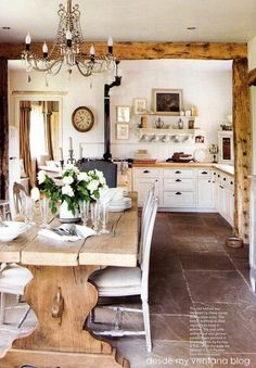 Country farmhouse style kitchen with dining space warmed up with wonderful wood benches and a weathered timber table... January | 2013 | Garden, Home & Party